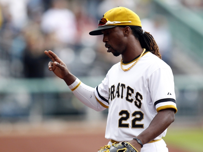Sep 22, 2013; Pittsburgh, PA, USA; Pittsburgh Pirates center fielder Andrew McCutchen (22) reacts to a standing ovation after being removed from the game against the Cincinnati Reds during the eighth inning at PNC Park. The Reds won 11-3. Mandatory Credit: Charles LeClaire-USA TODAY Sports