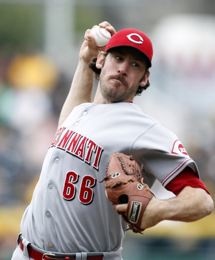 Sep 22, 2013; Pittsburgh, PA, USA; Cincinnati Reds relief pitcher Logan Ondrusek (66) pitches against the Pittsburgh Pirates during the ninth inning at PNC Park. The Reds won 11-3. Mandatory Credit: Charles LeClaire-USA TODAY Sports