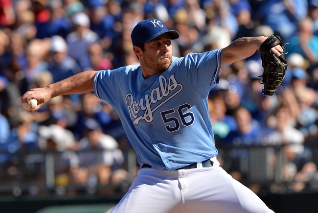 Sep 22, 2013; Kansas City, MO, USA; Kansas City Royals pitcher Greg Holland (56) delivers a pitch against the Texas Rangers during the ninth inning at Kauffman Stadium. The Royals beat the Rangers 4-0. Mandatory Credit: Peter G. Aiken-USA TODAY Sports