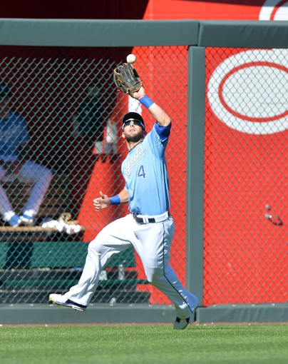 Sep 22, 2013; Kansas City, MO, USA; Kansas City Royals left fielder Alex Gordon (4) catches a fly ball against the Texas Rangers during the ninth inning at Kauffman Stadium. The Royals beat the Rangers 4-0. Mandatory Credit: Peter G. Aiken-USA TODAY Sports