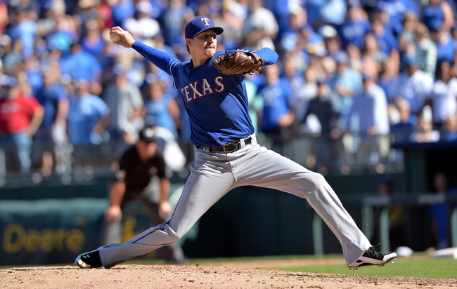 Sep 22, 2013; Kansas City, MO, USA; Texas Rangers pitcher Tanner Scheppers (52) delivers a pitch against the Kansas City Royals during the ninth inning at Kauffman Stadium. Mandatory Credit: Peter G. Aiken-USA TODAY Sports