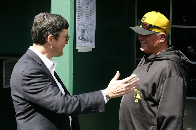 Sep 22, 2013; Pittsburgh, PA, USA; Pittsburgh Pirates owner Bob Nutting (left) talks to Pirates manager Clint Hurdle (13) in the dugout before the game against the Cincinnati Reds at PNC Park. The Reds won 11-3. Mandatory Credit: Charles LeClaire-USA TODAY Sports
