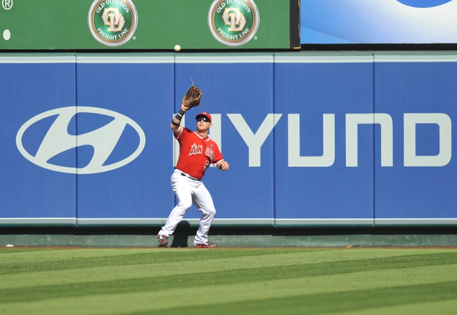 September 22, 2013; Anaheim, CA, USA; Los Angeles Angels right fielder Kole Calhoun (56) catches a fly ball during the sixth inning against the Seattle Mariners at Angel Stadium of Anaheim. Mandatory Credit: Gary A. Vasquez-USA TODAY Sports