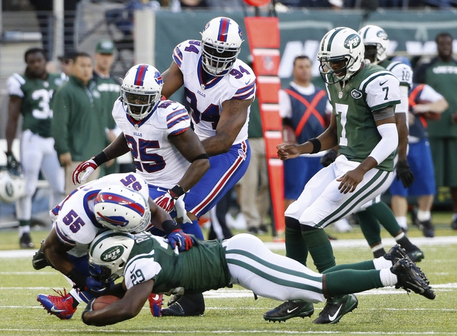Sep 22, 2013; East Rutherford, NJ, USA;  Buffalo Bills outside linebacker Jerry Hughes (55) tackles New York Jets running back Bilal Powell (29) during the second quarter at MetLife Stadium. Mandatory Credit: Anthony Gruppuso-USA TODAY Sports