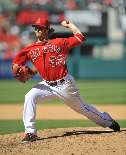 September 22, 2013; Anaheim, CA, USA; Los Angeles Angels starting pitcher C.J. Wilson (33) pitches during the sixth inning against the Seattle Mariners at Angel Stadium of Anaheim. Mandatory Credit: Gary A. Vasquez-USA TODAY Sports