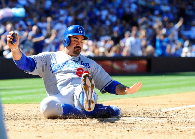Sep 22, 2013; San Diego, CA, USA; Los Angeles Dodgers first base Adrian Gonzalez (23) scores on a triple by third baseman Michael Young (not pictured) during the seventh inning against the San Diego Padres at Petco Park. Mandatory Credit: Christopher Hanewinckel-USA TODAY Sports