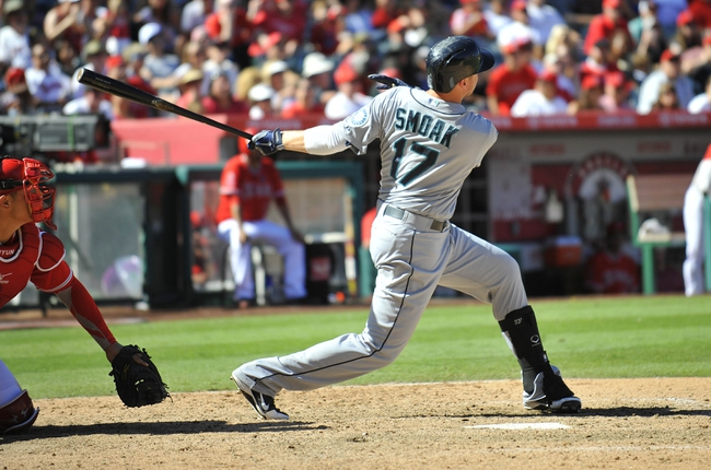 September 22, 2013; Anaheim, CA, USA; Seattle Mariners first baseman Justin Smoak (17) hits a two run home run during the sixth inning against the Los Angeles Angels at Angel Stadium of Anaheim. Mandatory Credit: Gary A. Vasquez-USA TODAY Sports