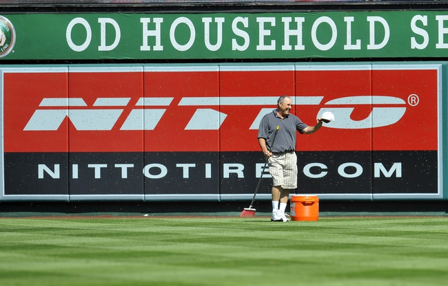 September 22, 2013; Anaheim, CA, USA; Los Angeles Angels fan John Poto is surrounded by a swarm of bees during a stoppage in play in the third inning at Angel Stadium of Anaheim. The game was delayed due to the bees on the field. Poto is a beekeeper who was in attendance for the game. Mandatory Credit: Gary A. Vasquez-USA TODAY Sports
