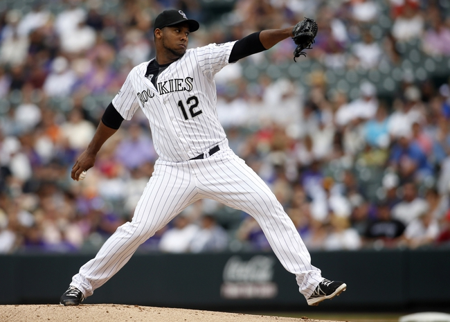 Sep 22, 2013; Denver, CO, USA; Colorado Rockies pitcher Juan Nicasio (12) delivers a pitch during the first inning against the Arizona Diamondbacks at Coors Field. Mandatory Credit: Chris Humphreys-USA TODAY Sports