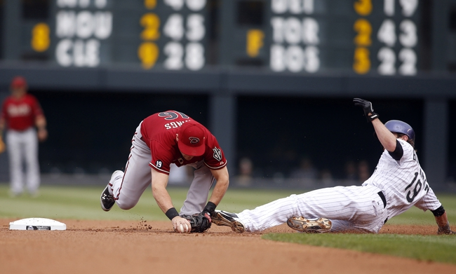 Sep 22, 2013; Denver, CO, USA; Colorado Rockies center fielder Charlie Blackmon (19) is tagged out at second base by Arizona Diamondback shortstop Chris Owsings (16) during the first inning at Coors Field. Mandatory Credit: Chris Humphreys-USA TODAY Sports