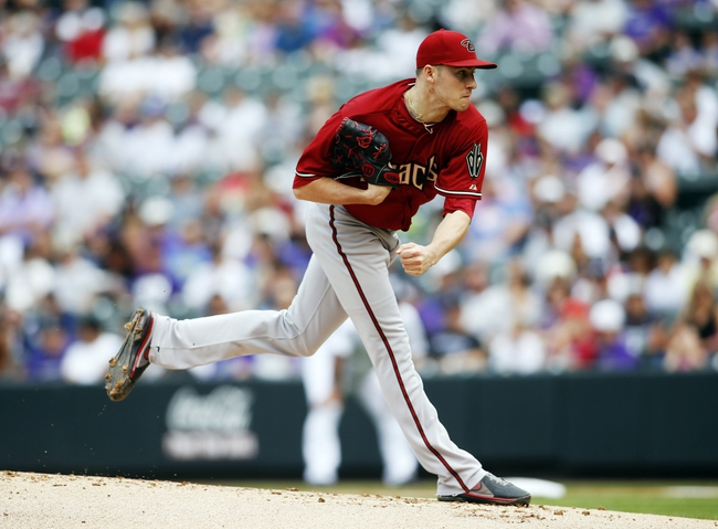 Sep 22, 2013; Denver, CO, USA; Arizona Diamondbacks pitcher Patrick Corbin (46) delivers a pitch during the first inning against the Colorado Rockies at Coors Field. Mandatory Credit: Chris Humphreys-USA TODAY Sports