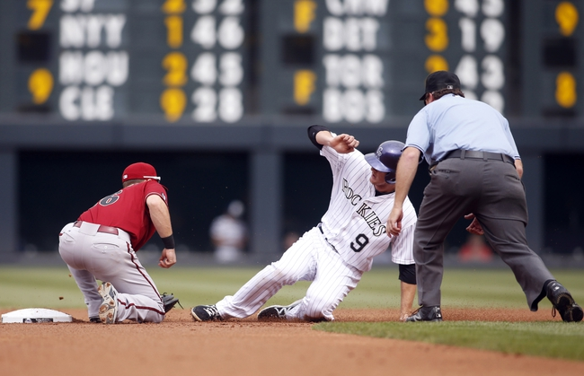 Sep 22, 2013; Denver, CO, USA; Colorado Rockies second baseman DJ LeMahieu (9) is tagged out stealing second base by Arizona Diamondback shortstop Chris Owsings (16) during the first inning at Coors Field. Mandatory Credit: Chris Humphreys-USA TODAY Sports