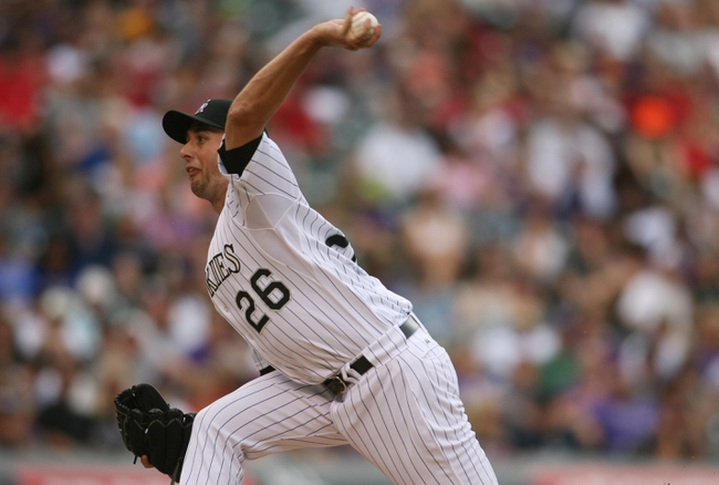 Sep 22, 2013; Denver, CO, USA; Colorado Rockies pitcher Jeff Francis (26) delivers a pitch during the third inning against the Arizona Diamondbacks at Coors Field. Mandatory Credit: Chris Humphreys-USA TODAY Sports
