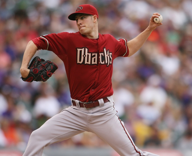 Sep 22, 2013; Denver, CO, USA; Arizona Diamondbacks pitcher Patrick Corbin (46) delivers a pitch during the third inning against the Colorado Rockies at Coors Field. Mandatory Credit: Chris Humphreys-USA TODAY Sports