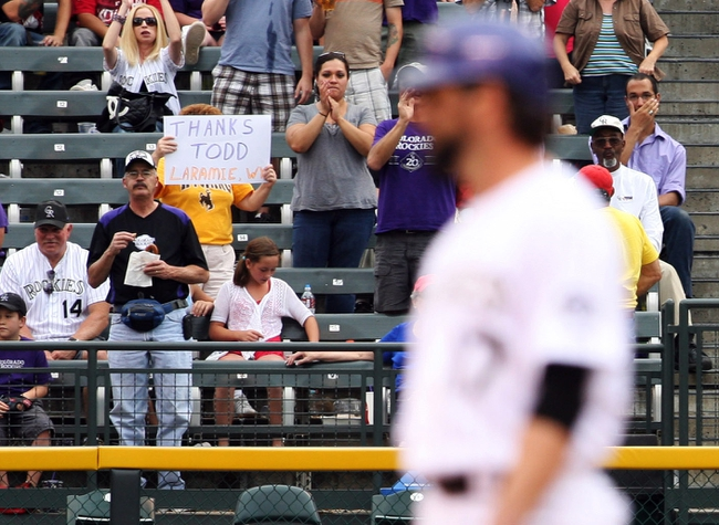 Sep 22, 2013; Denver, CO, USA; A fan holds a sign thanking Colorado Rockies first baseman Todd Helton (17) after Helton hit his 1400th career RBI during the fifth inning against the Arizona Diamondbacks at Coors Field. Mandatory Credit: Chris Humphreys-USA TODAY Sports