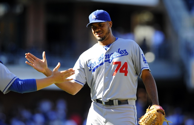 Sep 22, 2013; San Diego, CA, USA; Los Angeles Dodgers relief pitcher Kenley Jansen (74) celebrates after pitching a scoreless ninth inning against the San Diego Padres at Petco Park. The Dodgers won 1-0. Mandatory Credit: Christopher Hanewinckel-USA TODAY Sports