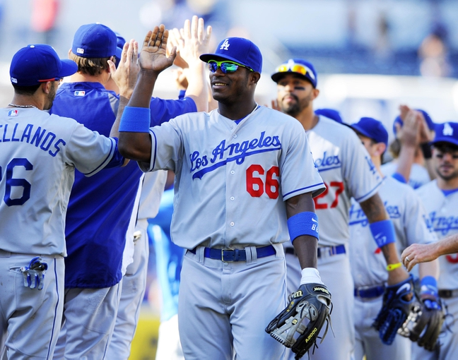 Sep 22, 2013; San Diego, CA, USA; Los Angeles Dodgers right fielder Yasiel Puig (66) celebrates with teammates after a 1-0 win against the San Diego Padres at Petco Park. Mandatory Credit: Christopher Hanewinckel-USA TODAY Sports