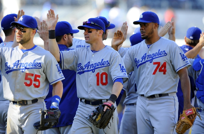 Sep 22, 2013; San Diego, CA, USA; Los Angeles Dodgers infielder Michael Young (10) celebrates with teammates after a 1-0 win against the San Diego Padres at Petco Park. Mandatory Credit: Christopher Hanewinckel-USA TODAY Sports
