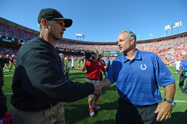 September 22, 2013; San Francisco, CA, USA; San Francisco 49ers head coach Jim Harbaugh (left) shakes hands with Indianapolis Colts head coach Chuck Pagano (right) after the game at Candlestick Park. The Colts defeated the 49ers 27-7. Mandatory Credit: Kyle Terada-USA TODAY Sports