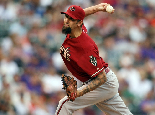 Sep 22, 2013; Denver, CO, USA; Arizona Diamondbacks pitcher Chaz Roe (34) deliver a pitch during the sixth inning against the Colorado Rockies at Coors Field. Mandatory Credit: Chris Humphreys-USA TODAY Sports