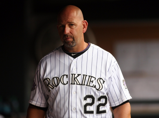 Sep 22, 2013; Denver, CO, USA; Colorado Rockies manager Walt Weiss (22) in the dugout during the sixth inning against the Arizona Diamondbacks at Coors Field. Mandatory Credit: Chris Humphreys-USA TODAY Sports
