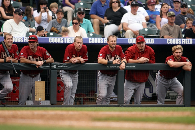 Sep 22, 2013; Denver, CO, USA; Members of the Arizona Diamondbacks watch from the dugout during the sixth inning against the Colorado Rockies at Coors Field. Mandatory Credit: Chris Humphreys-USA TODAY Sports