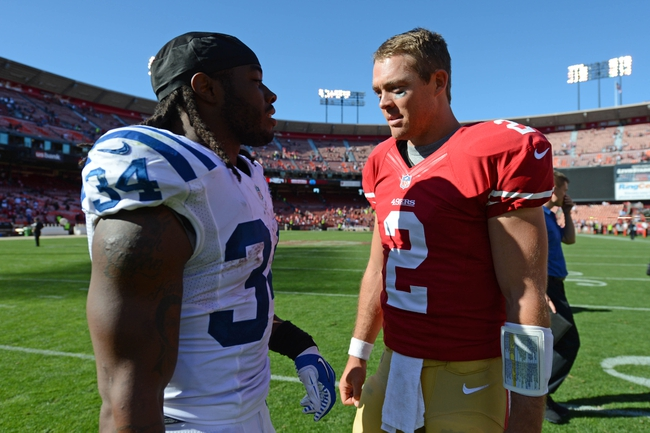 September 22, 2013; San Francisco, CA, USA; Indianapolis Colts running back Trent Richardson (34) talks to San Francisco 49ers quarterback Colt McCoy (2) after the game at Candlestick Park. The Colts defeated the 49ers 27-7. Mandatory Credit: Kyle Terada-USA TODAY Sports