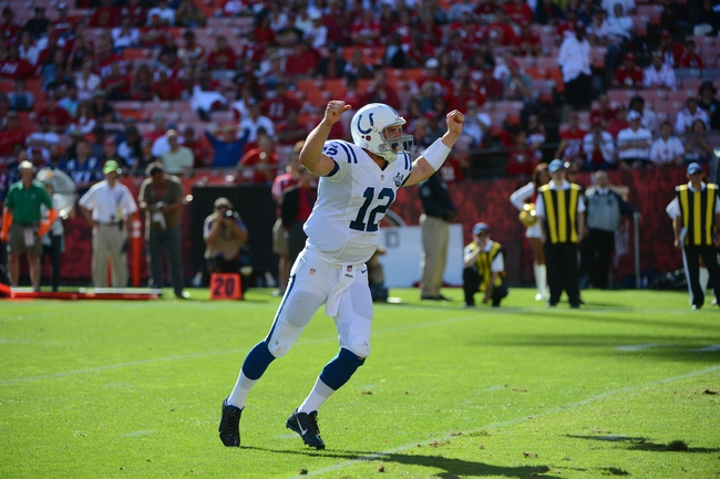 September 22, 2013; San Francisco, CA, USA; Indianapolis Colts quarterback Andrew Luck (12) celebrates after running back Ahmad Bradshaw (44, not pictured) scored a 1-yard touchdown run during the fourth quarter against the San Francisco 49ers at Candlestick Park. Mandatory Credit: Kyle Terada-USA TODAY Sports