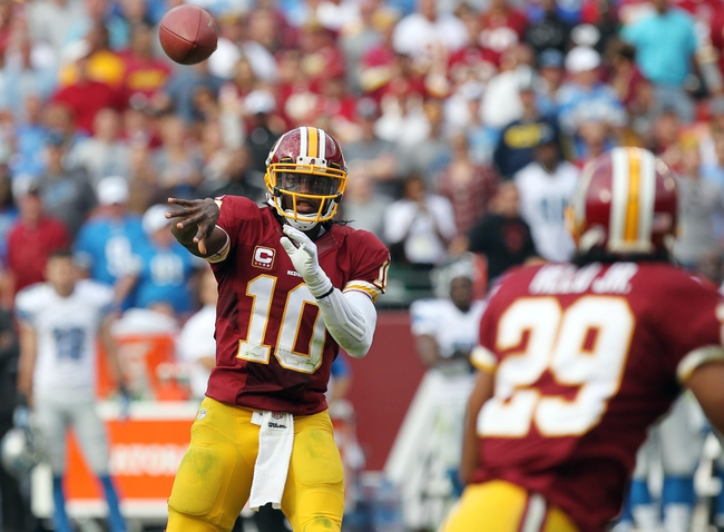Sep 22, 2013; Landover, MD, USA; Washington Redskins quarterback Robert Griffin III (10) throws the ball to Redskins running back Roy Helu (29) against the Detroit Lions in the fourth quarter at FedEx Field. The Lions won 27-20. Mandatory Credit: Geoff Burke-USA TODAY Sports