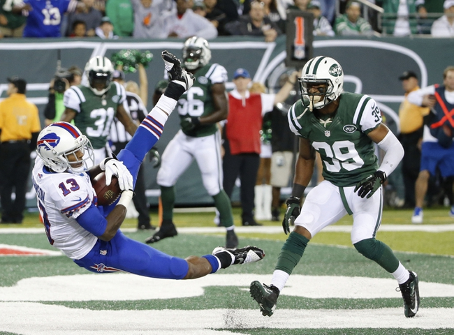 Sep 22, 2013; East Rutherford, NJ, USA; Buffalo Bills wide receiver Steve Johnson (13) scores for the two point conversion during the fourth quarter against the New York Jets at MetLife Stadium. Mandatory Credit: Anthony Gruppuso-USA TODAY Sports