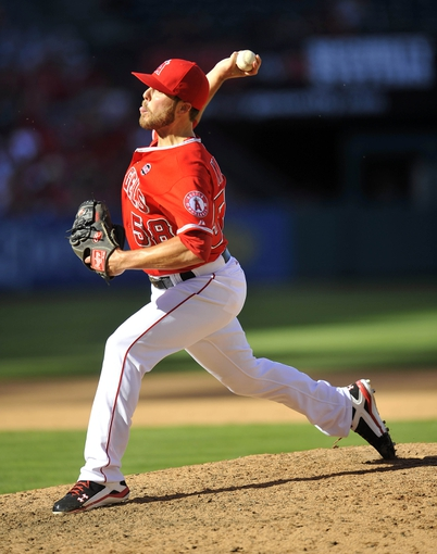September 22, 2013; Anaheim, CA, USA; Los Angeles Angels relief pitcher Michael Kohn (58) pitches during the ninth inning against the Seattle Mariners at Angel Stadium of Anaheim. Mandatory Credit: Gary A. Vasquez-USA TODAY Sports