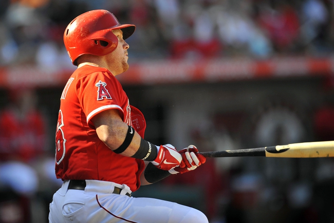 September 22, 2013; Anaheim, CA, USA; Los Angeles Angels right fielder Kole Calhoun (56) hits a solo home run during the eighth inning against the Seattle Mariners at Angel Stadium of Anaheim. Mandatory Credit: Gary A. Vasquez-USA TODAY Sports