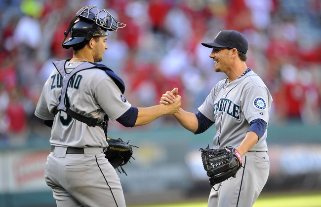 September 22, 2013; Anaheim, CA, USA; Seattle Mariners relief pitcher Danny Farquhar (40) and catcher Mike Zunino (3) celebrate the 3-2 victory against the Los Angeles Angels at Angel Stadium of Anaheim. Mandatory Credit: Gary A. Vasquez-USA TODAY Sports