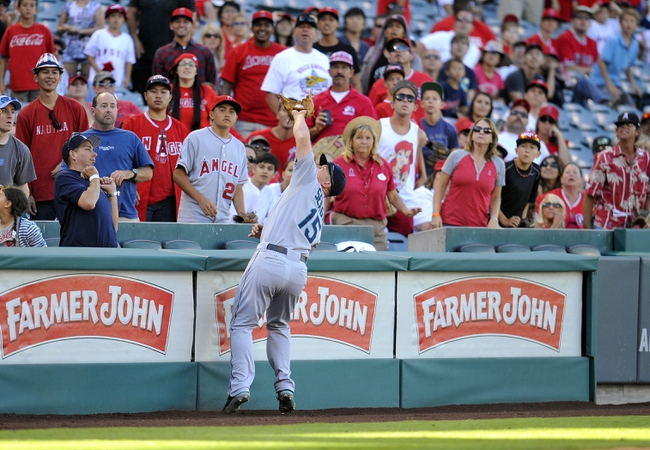 September 22, 2013; Anaheim, CA, USA; Seattle Mariners third baseman Kyle Seager (15) catches a fly ball in foul territory for the final out of the ninth inning against the Los Angeles Angels at Angel Stadium of Anaheim. Mandatory Credit: Gary A. Vasquez-USA TODAY Sports