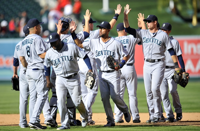 September 22, 2013; Anaheim, CA, USA; Seattle Mariners celebrate their 3-2 victory against the Los Angeles Angels at Angel Stadium of Anaheim. Mandatory Credit: Gary A. Vasquez-USA TODAY Sports