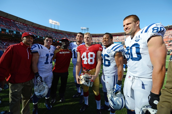 September 22, 2013; San Francisco, CA, USA; Stanford Cardinal alums (L-R) San Francisco 49ers equipment assistant Jonathan Segovia, Indianapolis Colts wide receiver Griff Whalen (17), 49ers safety Michael Thomas, Colts quarterback Andrew Luck (12), 49ers running back Owen Marecic (48), Colts defensive back Delano Howell (26), and Colts tight end Coby Fleener (80) pose for a photo after the game at Candlestick Park. The Colts defeated the 49ers 27-7. Mandatory Credit: Kyle Terada-USA TODAY Sports