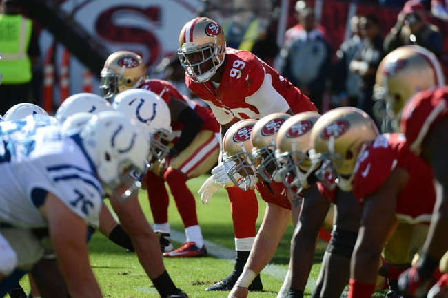 September 22, 2013; San Francisco, CA, USA; San Francisco 49ers outside linebacker Aldon Smith (99) stands at the line of scrimmage against the Indianapolis Colts during the fourth quarter at Candlestick Park. Mandatory Credit: Kyle Terada-USA TODAY Sports