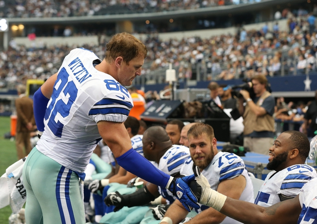 Sep 22, 2013; Arlington, TX, USA; Dallas Cowboys tight end Jason Witten (82) celebrates a victory with the offensive line on the sidelines against the St. Louis Rams at AT&T Stadium. The Dallas Cowboys beat St. Louis Rams 31-7. Mandatory Credit: Matthew Emmons-USA TODAY Sports