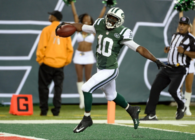 Sep 22, 2013; East Rutherford, NJ, USA; New York Jets wide receiver Santonio Holmes (10) scores a touchdown in the fourth quarter against the Buffalo Bills at MetLife Stadium. Mandatory Credit: Robert Deutsch-USA TODAY Sports