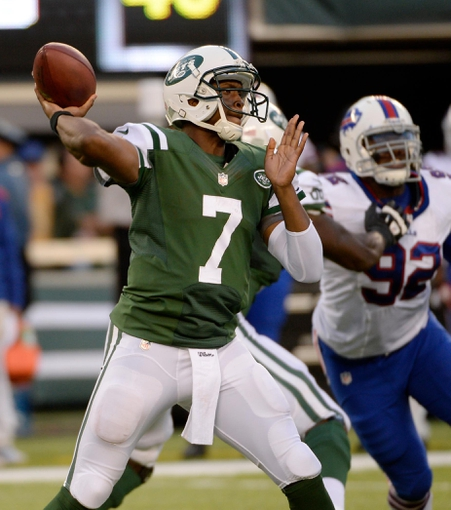 Sep 22, 2013; East Rutherford, NJ, USA; New York Jets quarterback Geno Smith (7) throws a pass against the Buffalo Bills in the second half at MetLife Stadium. Mandatory Credit: Robert Deutsch-USA TODAY Sports