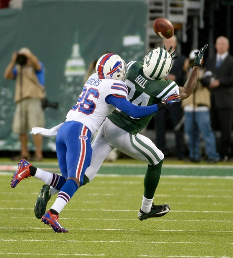 Sep 22, 2013; East Rutherford, NJ, USA; Buffalo Bills defensive back Justin Rogers (26) is called for pass interference against New York Jets wide receiver Stephen Hill (84) in the 3rd quarter at MetLife Stadium. Mandatory Credit: Robert Deutsch-USA TODAY Sports