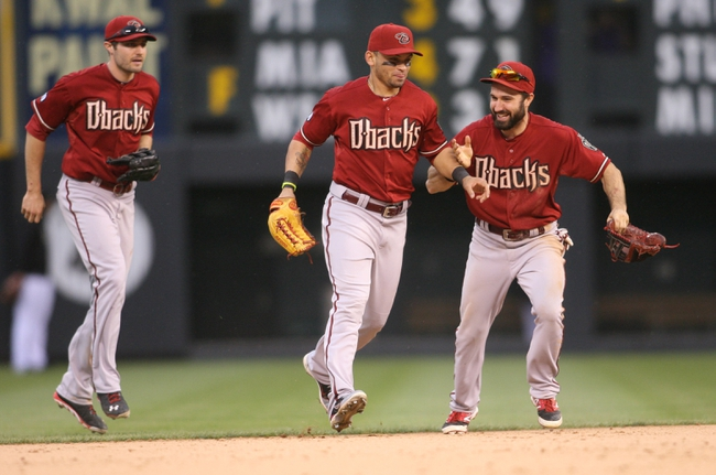 Sep 22, 2013; Denver, CO, USA; Arizona Diamondbacks left fielder Adam Eaton (left), center fielder A.J. Pollock (center) and right fielder Gerardo Parra (left) celebrate after the ninth inning against the Colorado Rockies  at Coors Field. The Diamondbacks won 13-9.  Mandatory Credit: Chris Humphreys-USA TODAY Sports
