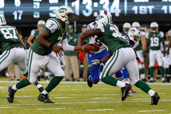 Sep 22, 2013; East Rutherford, NJ, USA;  New York Jets quarterback Geno Smith (7) hands off to running back Bilal Powell (29) during the third quarter against the Buffalo Bills at MetLife Stadium. Mandatory Credit: Anthony Gruppuso-USA TODAY Sports