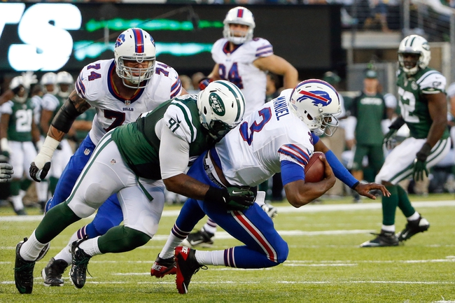 Sep 22, 2013; East Rutherford, NJ, USA;  New York Jets defensive end Sheldon Richardson (91) sacks Buffalo Bills quarterback EJ Manuel (3) during the third quarter at MetLife Stadium. Mandatory Credit: Anthony Gruppuso-USA TODAY Sports
