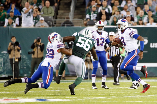 Sep 22, 2013; East Rutherford, NJ, USA;  Buffalo Bills quarterback EJ Manuel (3) carries the ball during the fourth quarter against the New York Jets at MetLife Stadium. Mandatory Credit: Anthony Gruppuso-USA TODAY Sports