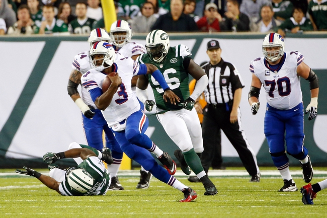 Sep 22, 2013; East Rutherford, NJ, USA;  Buffalo Bills quarterback EJ Manuel (3) scrambles during the fourth quarter against the New York Jets at MetLife Stadium. Mandatory Credit: Anthony Gruppuso-USA TODAY Sports