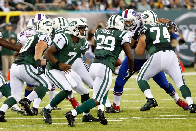 Sep 22, 2013; East Rutherford, NJ, USA;  New York Jets quarterback Geno Smith (7) hands off to running back Bilal Powell (29) during the fourth quarter against the Buffalo Bills at MetLife Stadium. Mandatory Credit: Anthony Gruppuso-USA TODAY Sports
