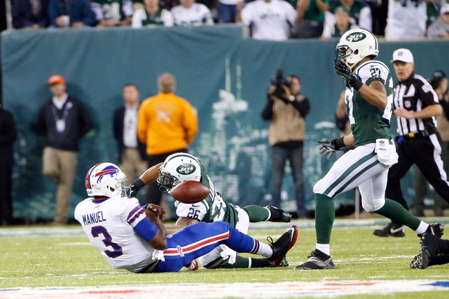 Sep 22, 2013; East Rutherford, NJ, USA;  New York Jets strong safety Dawan Landry (26) tackles Buffalo Bills quarterback EJ Manuel (3) during the fourth quarter at MetLife Stadium. Mandatory Credit: Anthony Gruppuso-USA TODAY Sports
