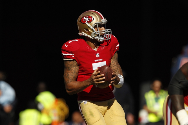 Sep 22, 2013; San Francisco, CA, USA; San Francisco 49ers quarterback Colin Kaepernick (7) backs up to pass against the Indianapolis Colts in the fourth quarter at Candlestick Park. The Colts defeated the 49ers 27-7. Mandatory Credit: Cary Edmondson-USA TODAY Sports