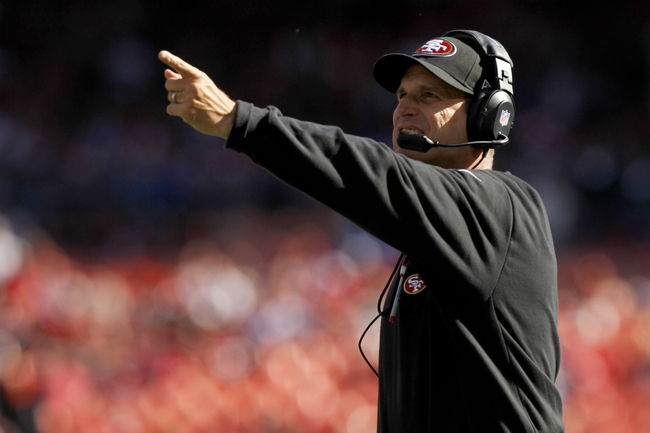Sep 22, 2013; San Francisco, CA, USA; San Francisco 49ers head coach Jim Harbaugh points towards the scoreboard after calling a timeout against the Indianapolis Colts in the fourth quarter at Candlestick Park. The Colts defeated the 49ers 27-7. Mandatory Credit: Cary Edmondson-USA TODAY Sports